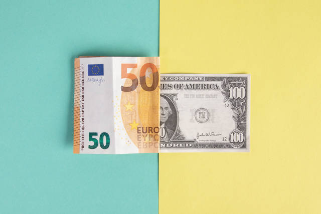Folded 50 Euro and 100 Dollar banknotes