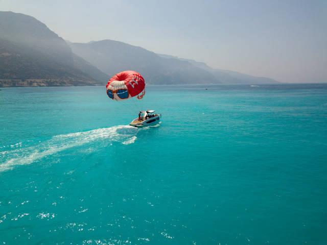 Getting the parachute ready for parasailing. Fethiye Ölüdeniz, Turkey