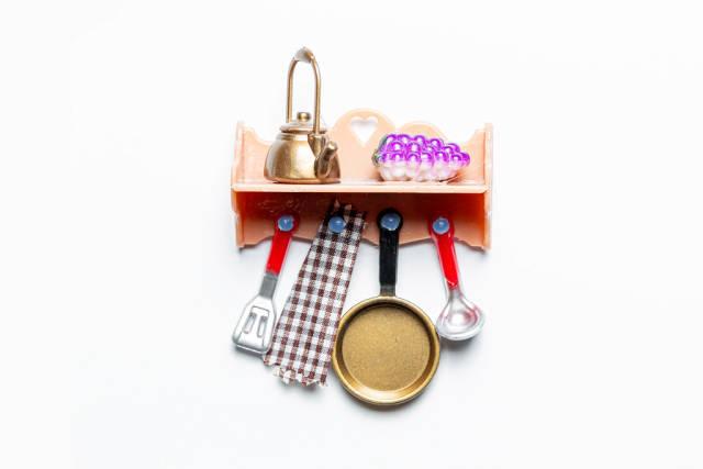 Toy shelf with kitchen utensils