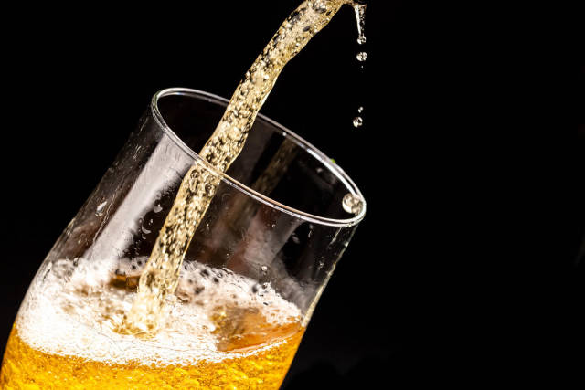 Close-up of light beer with bubbles and splashes