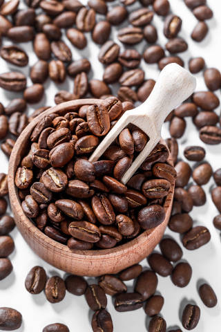 Coffee beans in a wooden bowl background