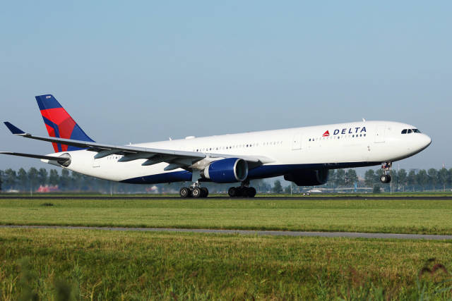 Delta airplane taking off from Polderbaan, Amsterdam Airport, AMS