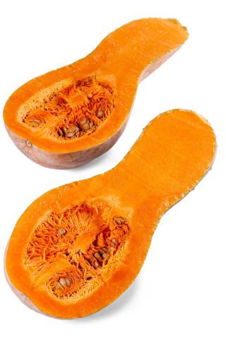 Halves of fresh raw butternut pumpkin