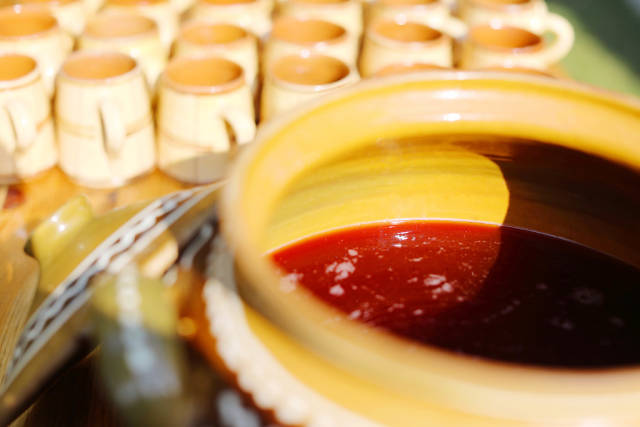 Grape must in ceramic pot