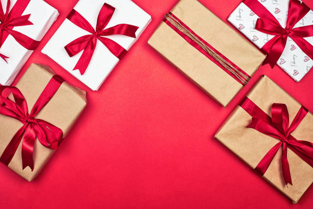 Collection of different handmade gift boxes on red