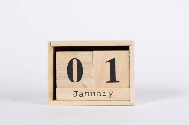 Day 1st of January set on wooden calendar
