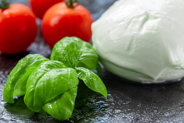 Fresh Basil leaves, tomatoes and mozzarella cheese