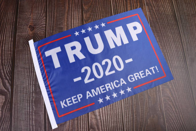Trump 2020 flag on wooden background