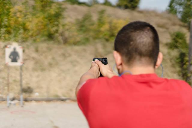 Back View of Man Firing The Gun