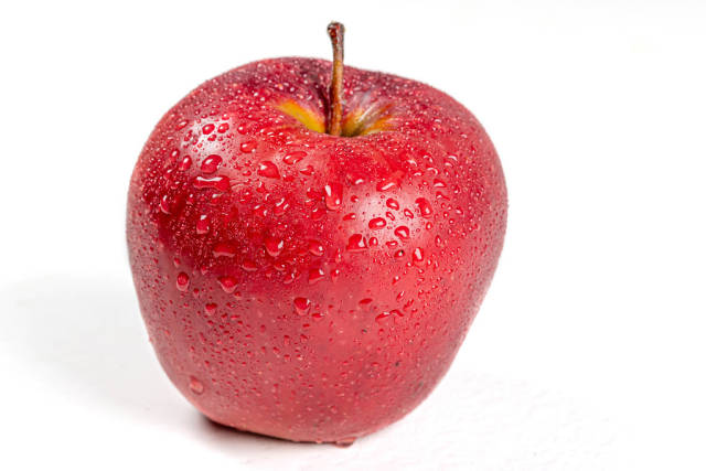 Red ripe apple with drops of water