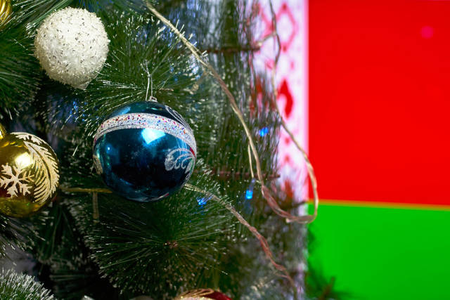 Decorated Christmas tree against the Belarus flag