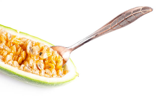 Half ripe curuba with spoon