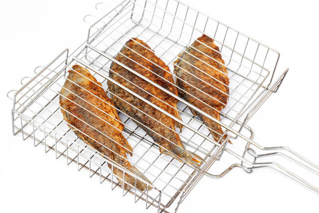 Grilled european carps on the grill grates
