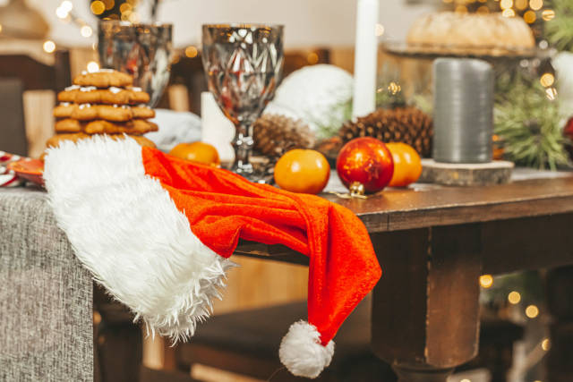 Santa claus hat on christmas table