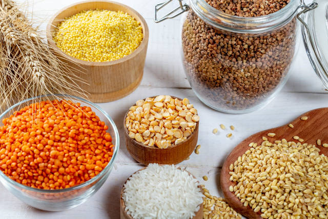 Bowls with different cereals: rice, millet, lentils, peas, buckwheat