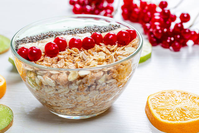 The concept of a healthy Breakfast - oatmeal with fruit and Chia seeds