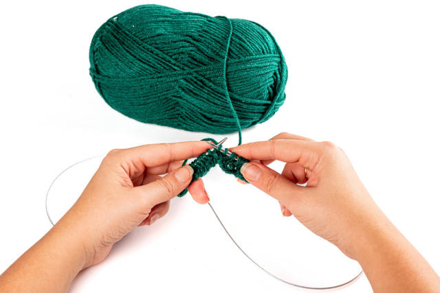 Close-up, womens hands knitting needles