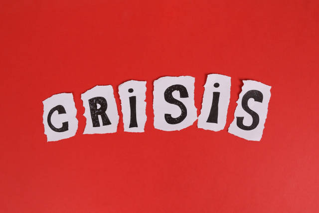 Crisis text on red background
