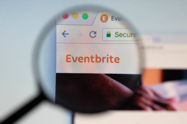 Eventbrite logo on a computer screen with a magnifying glass