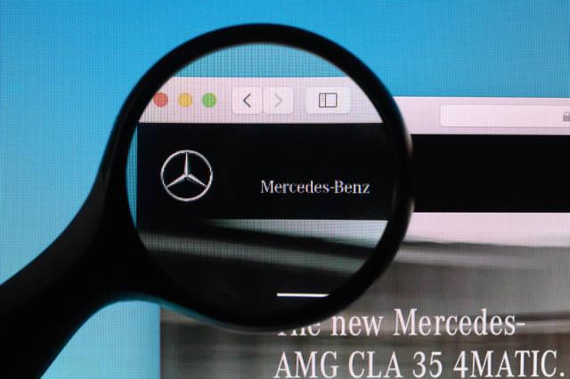 Mercedes-Benz logo under magnifying glass