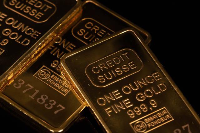 Gold bars close-up on black background