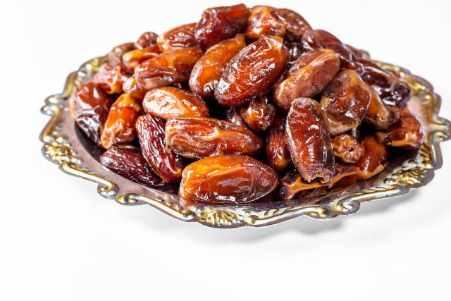 Dried dates on a silver tray