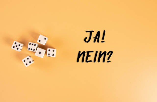 White dices with Ja! and Nein? text on orange background