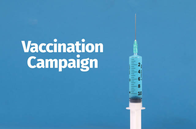 Medical syringe with Vaccination Campaign text