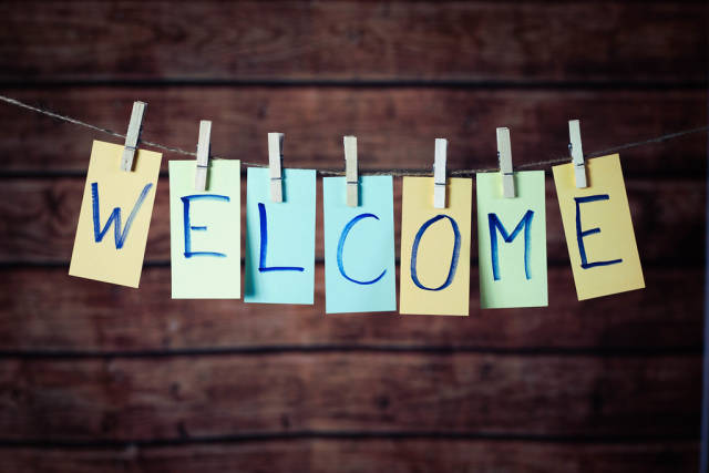 Welcome text hanging on the rope