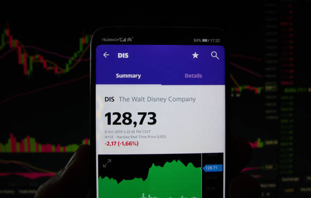 A smartphone displays the Walt Disney Company market value