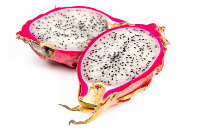 Halves of cactus fruits - pitahaya on white