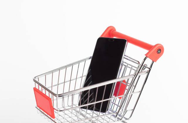 Black smartphone in shopping cart