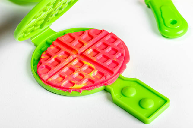 Childrens toy waffle iron and plasticine