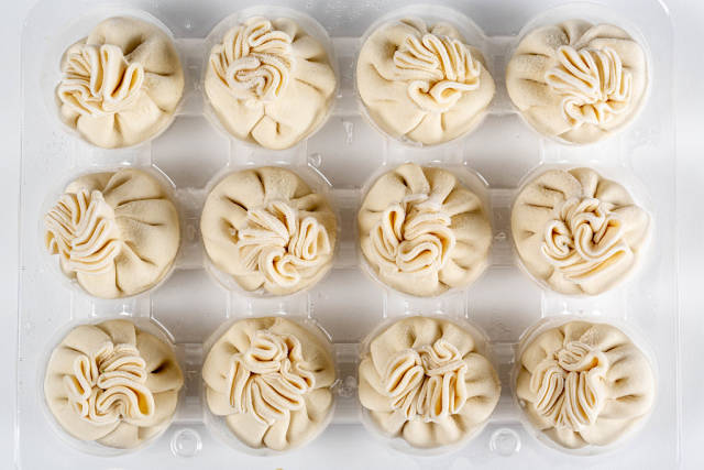Uncooked khinkali, traditional Georgian cuisine, top view
