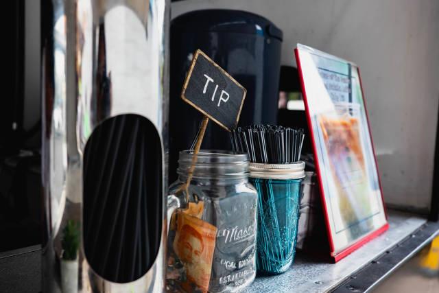 Tip jar alongside condiments