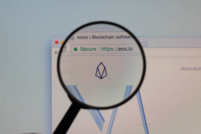 EOS logo on a computer screen with a magnifying glass