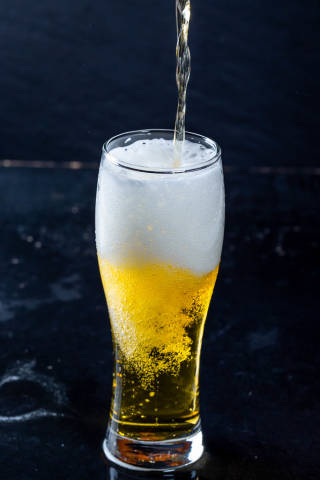 The process of pouring beer into a glass