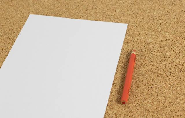 Black white paper with red pencil