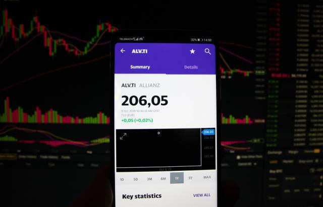 A smartphone displays the Allianz market value