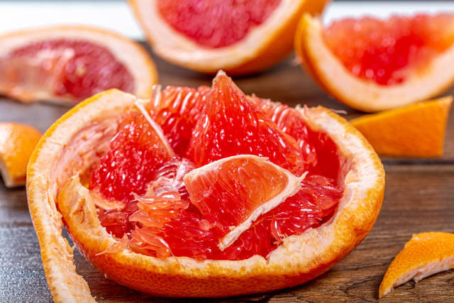 Pulp of ripe grapefruit and its peel close-up