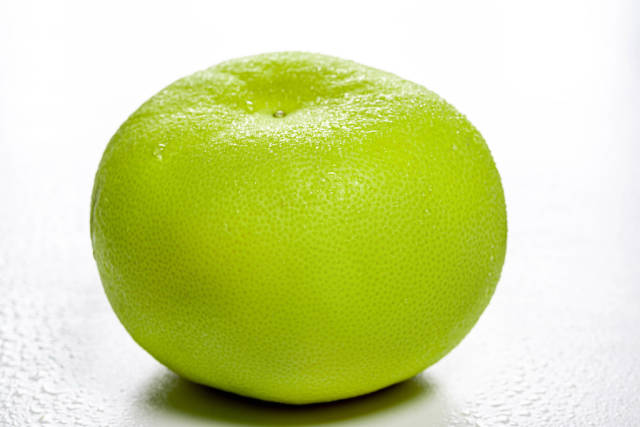 One whole Citrus Sweetie (Oroblanco ) on white background