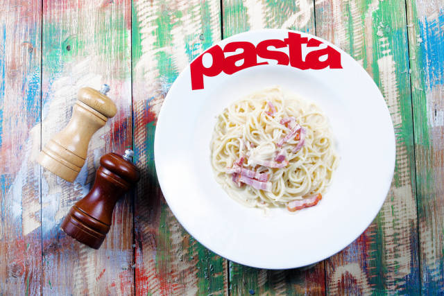 Spaghetti carbonara with bacon and parmesan, pasta plate, wooden background