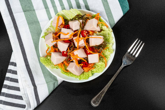 Top view dietary salad with chicken and vegetables