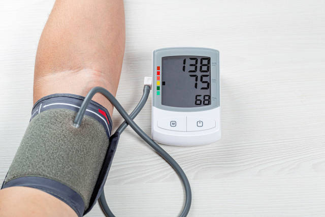 Human check blood pressure and heart rate with digital pressure gauge. Health care and Medical concept