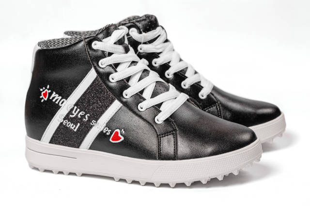 Side view of a on womens black sneakers
