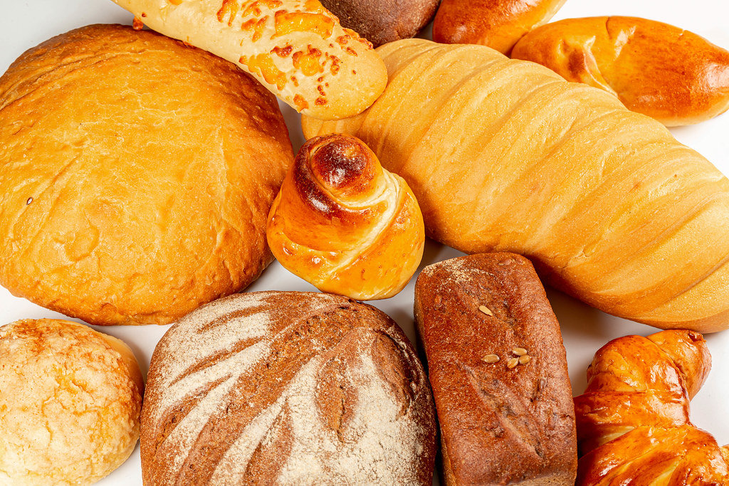 Bakery products background with breads and buns