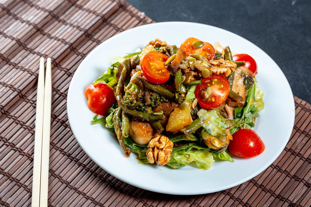 Vegan salad with fresh vegetables and grilled mushrooms