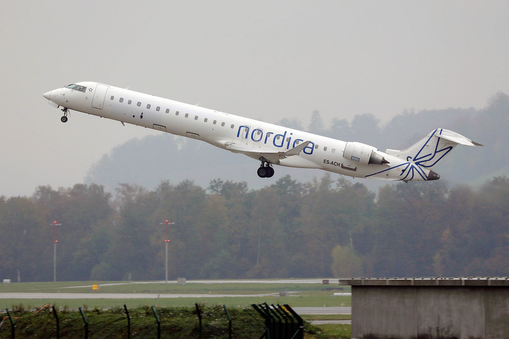 Nordica Bombardier airplane taking off from Zurich Airport