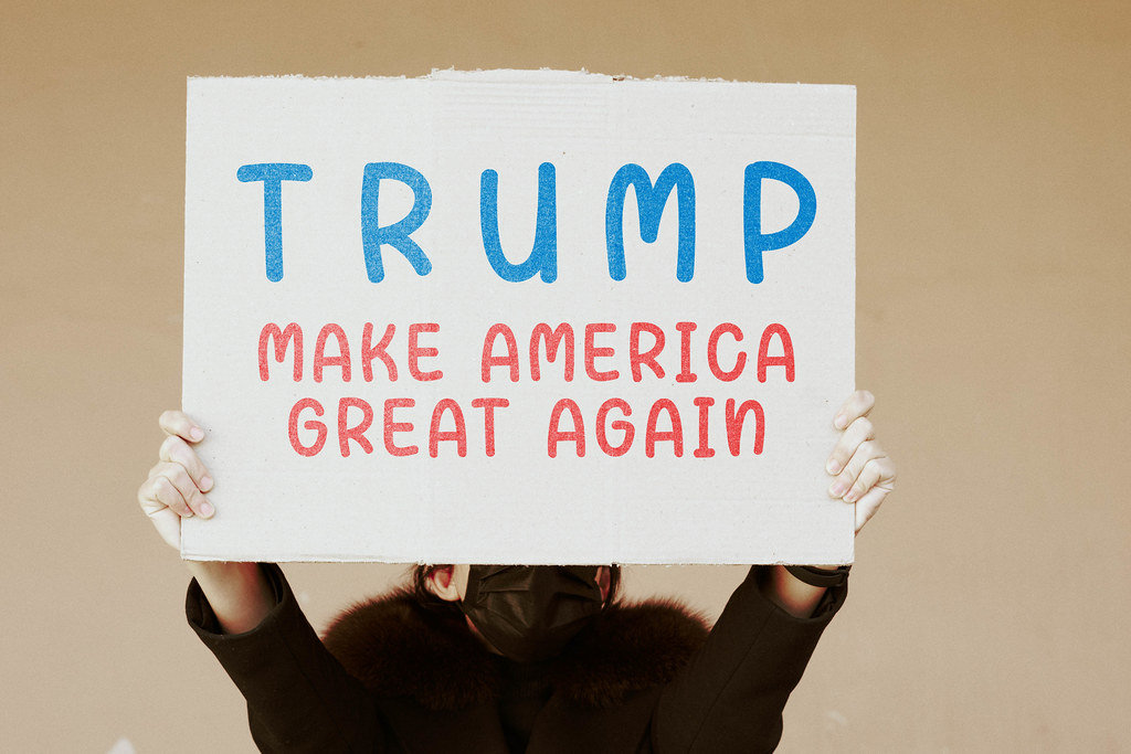 Pro-Trump US citizen holds a placard with words - Make America Great Again