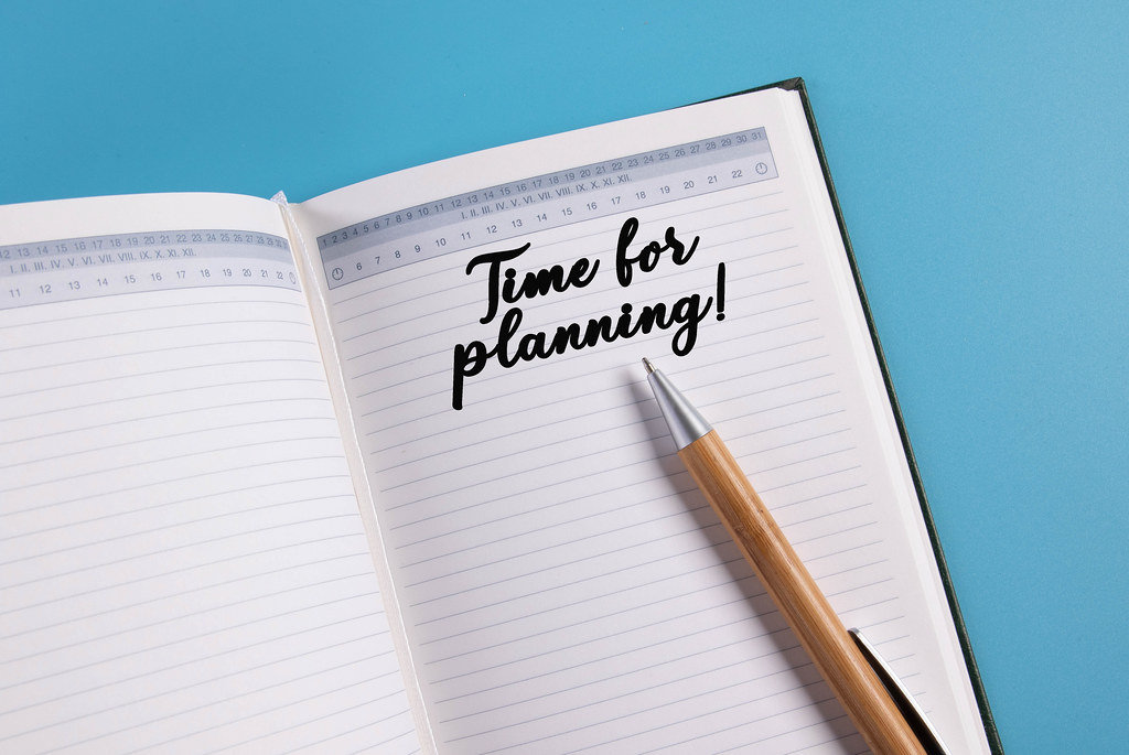 Open notebook with Time for planning text on blue background